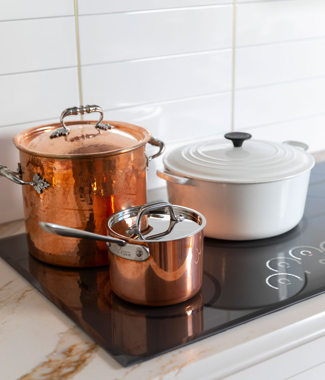 copper and iron pots on induction cootop