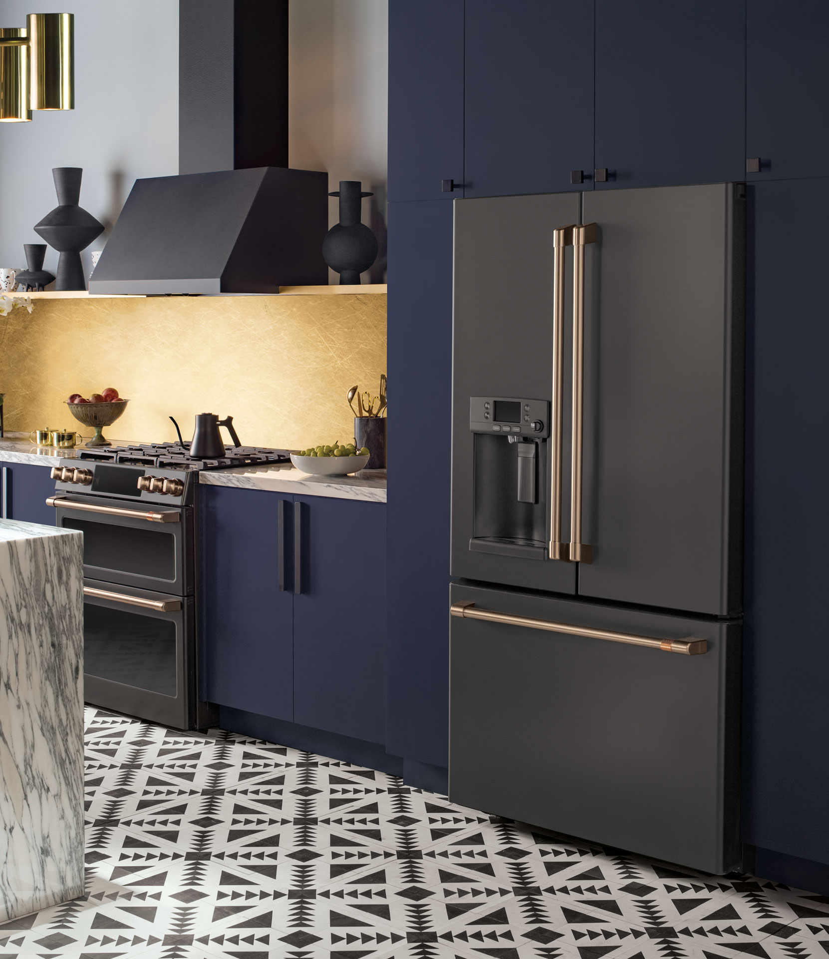 matte black double oven, range hood, and french door refrigerator with blue cabinets