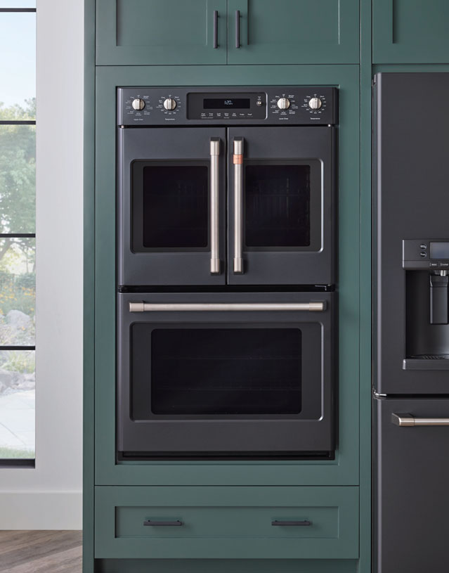 matte black french door double oven with green cabinets