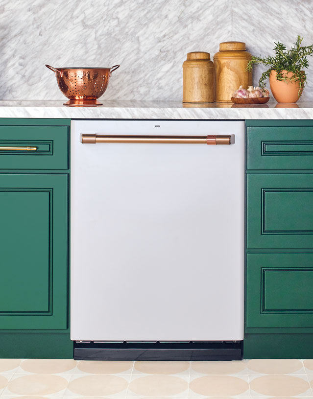 matte white dishwasher with green cabinets