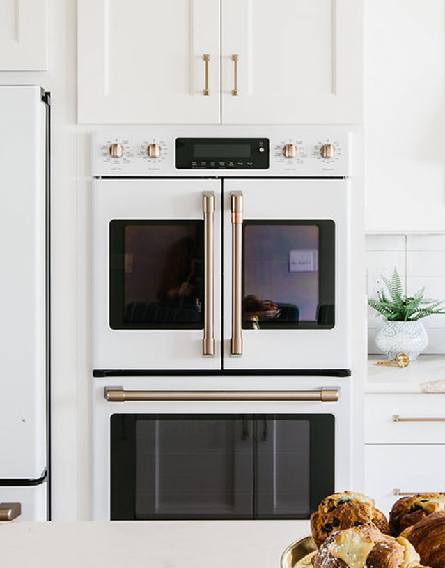 matte white french door double wall oven with white cabinets