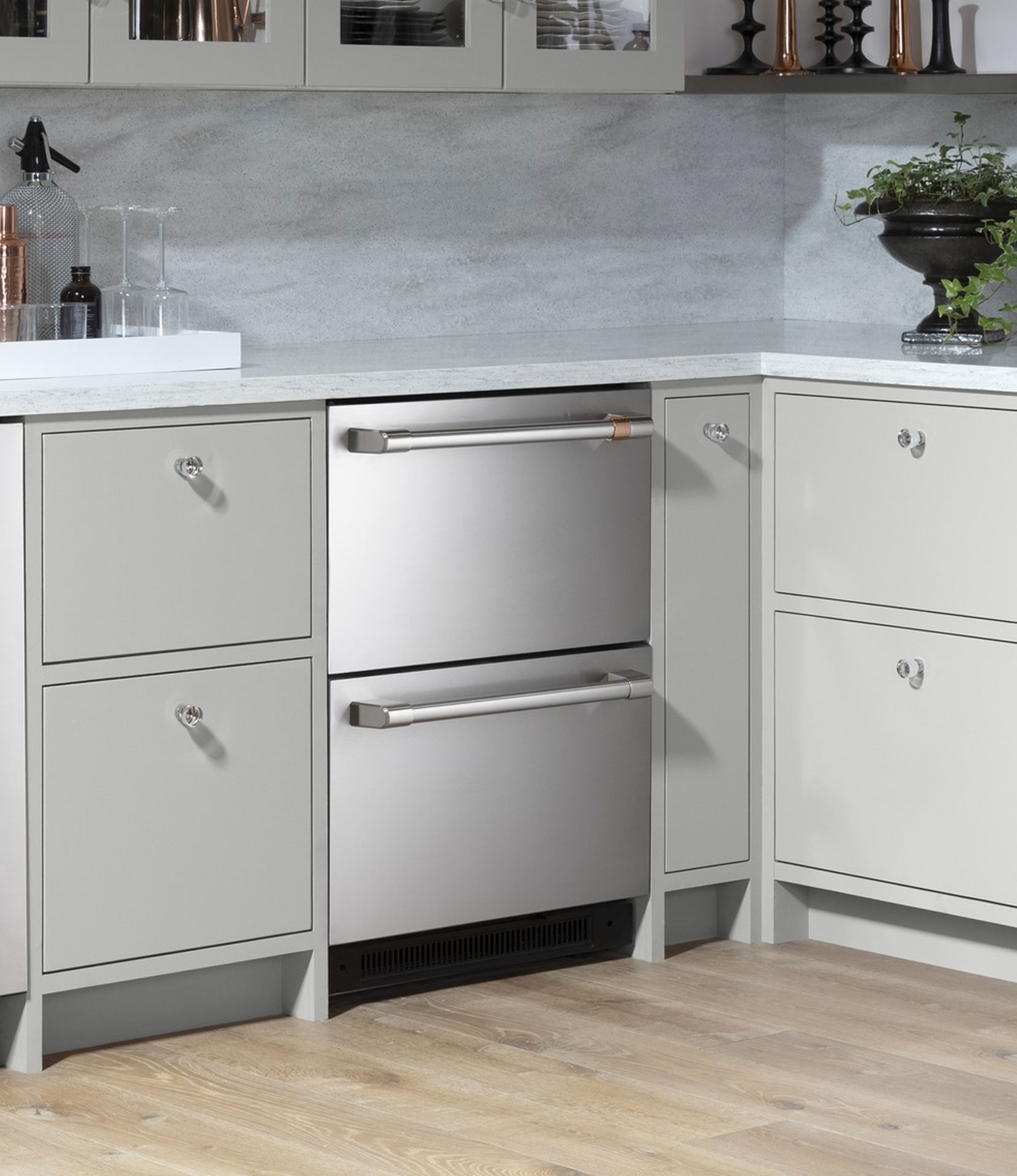 stainless steel double drawer refrigerator with grey cabinets