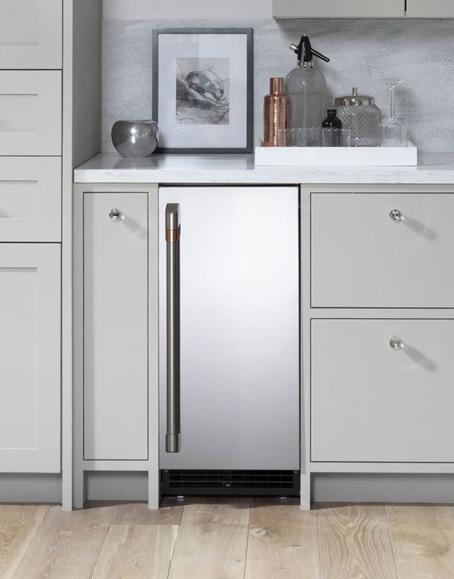stainless steel ice maker with grey cabinets