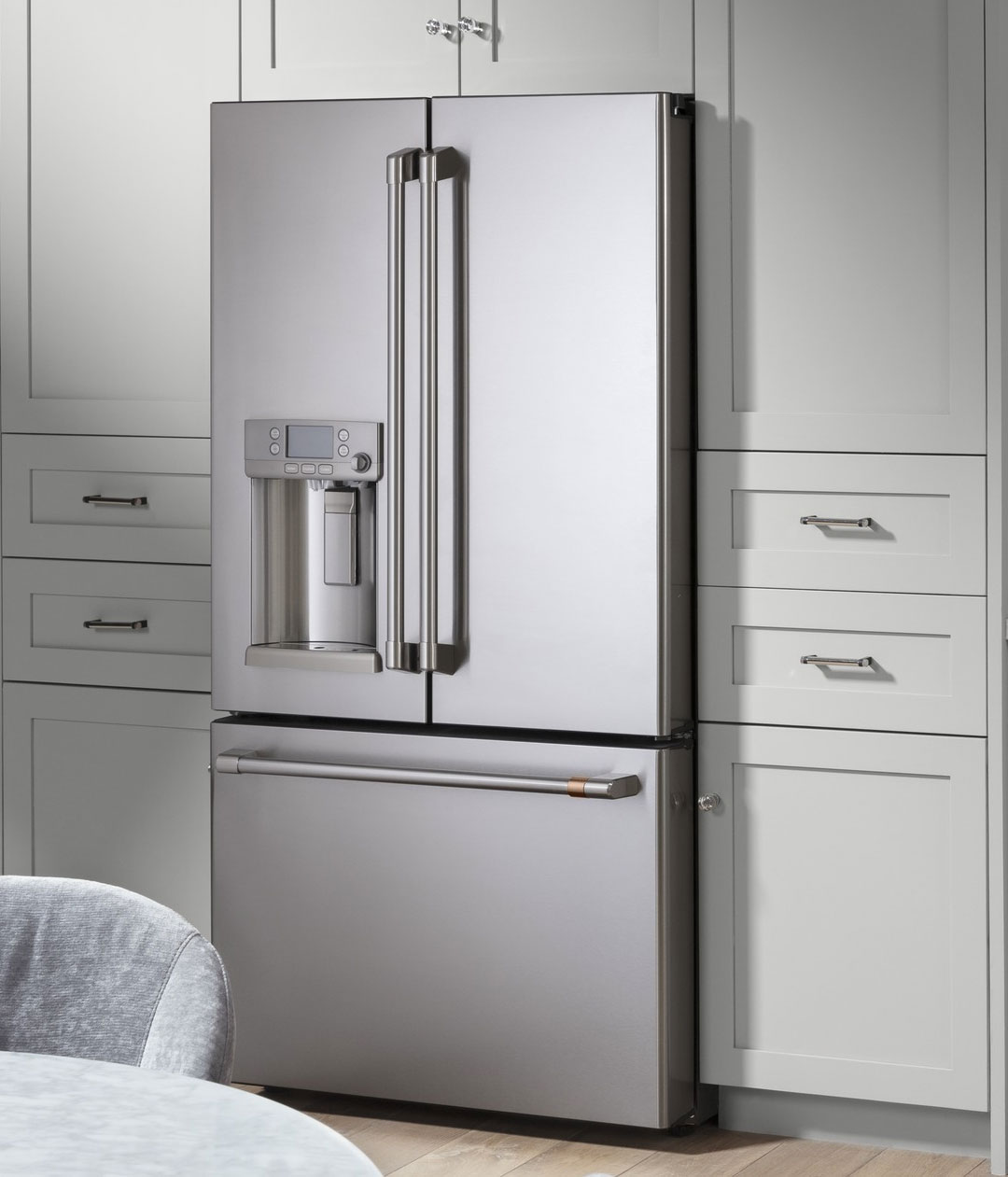 stainless steel refrigerator with grey cabinets