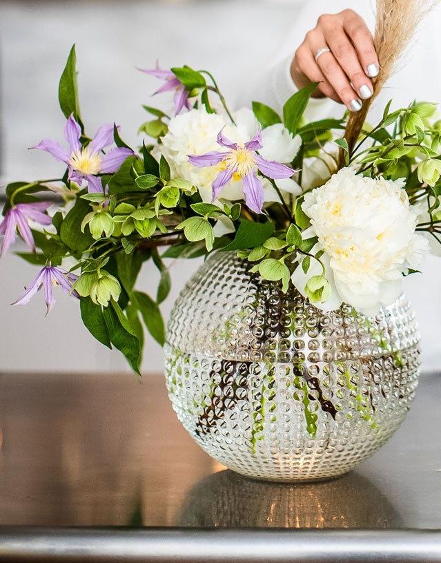 arranging flowers in vase