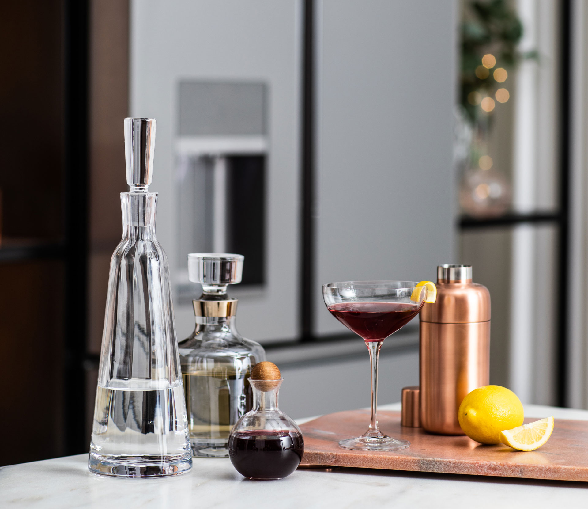 Cocktails in front of the Modern Glass refrigerator