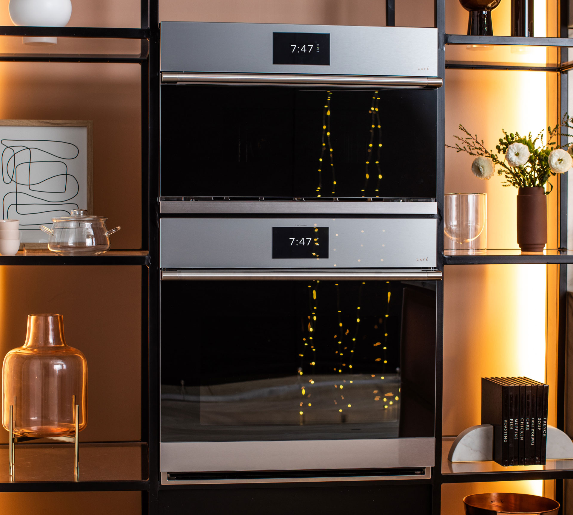 Modern Glass wall ovens with sparkly lights reflected in them
