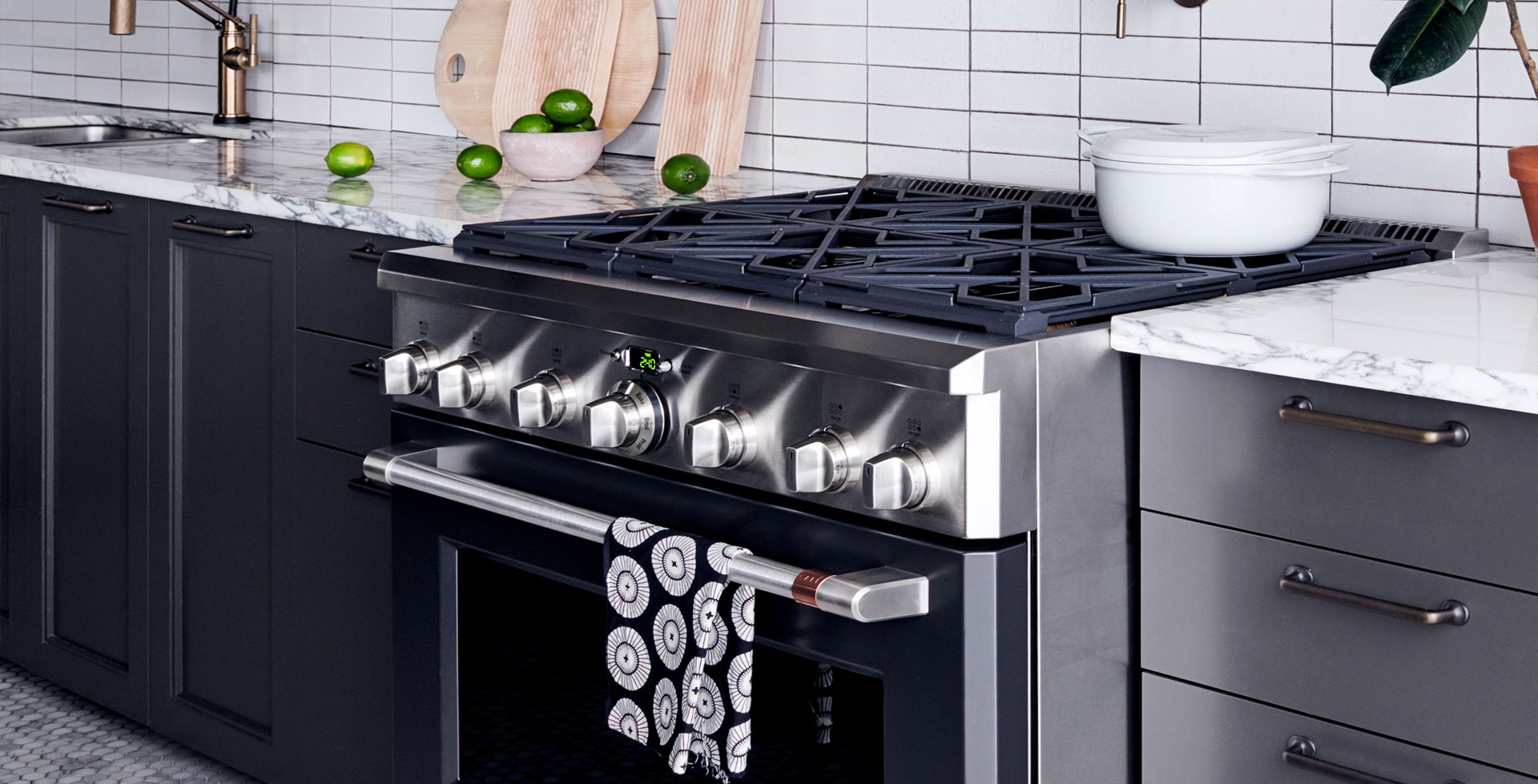 matte black gas range with towel hanging on handle