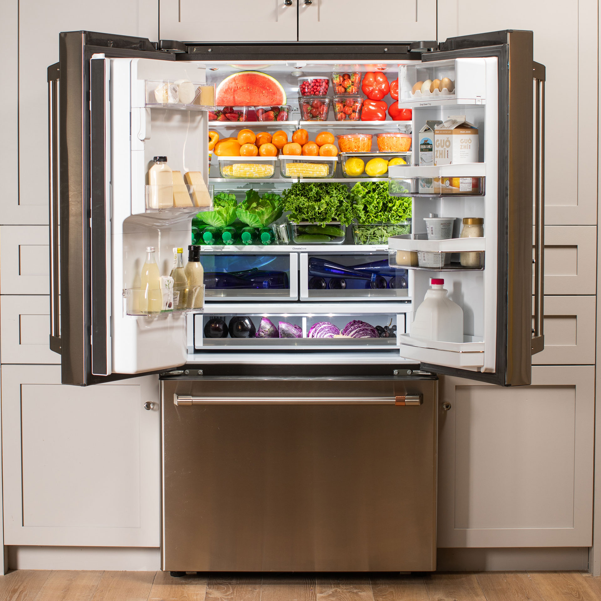 Stainless steel Cafe refrigerator with doors open showing a rainbow of produce