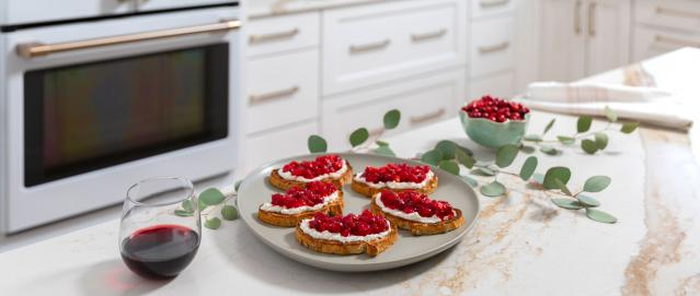 cranberry chèvre crostini on island with garland