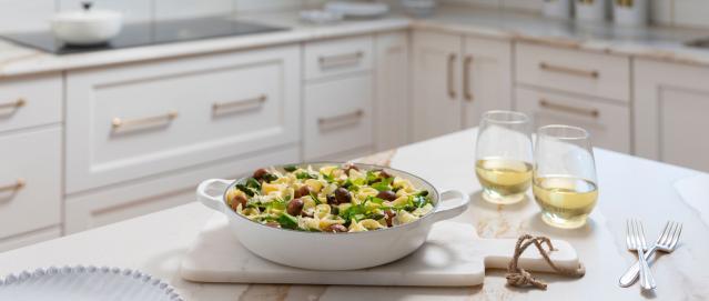 spring veggie orecchiette on counter with wine