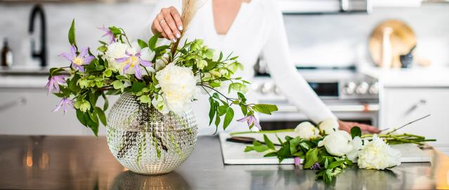 arranging spring flowers in vase