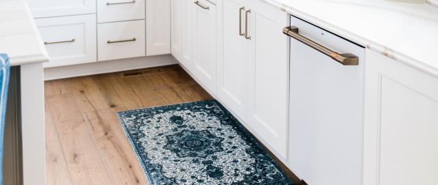 Matte white dishwasher in white cabinets