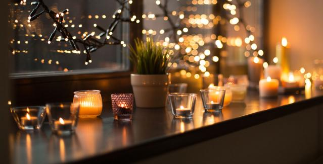 Candles add warmth and soft glow to the kitchen