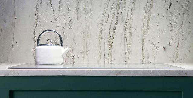 Marble backsplash behind induction cooktop