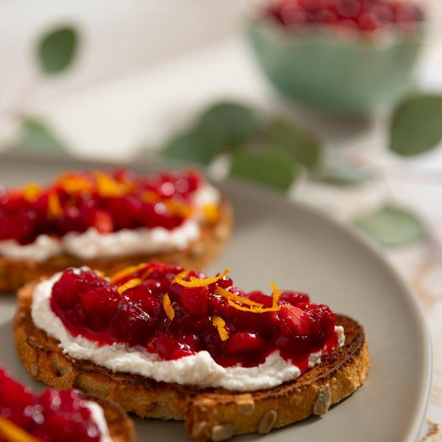 closeup finished cranberry chevre crostini