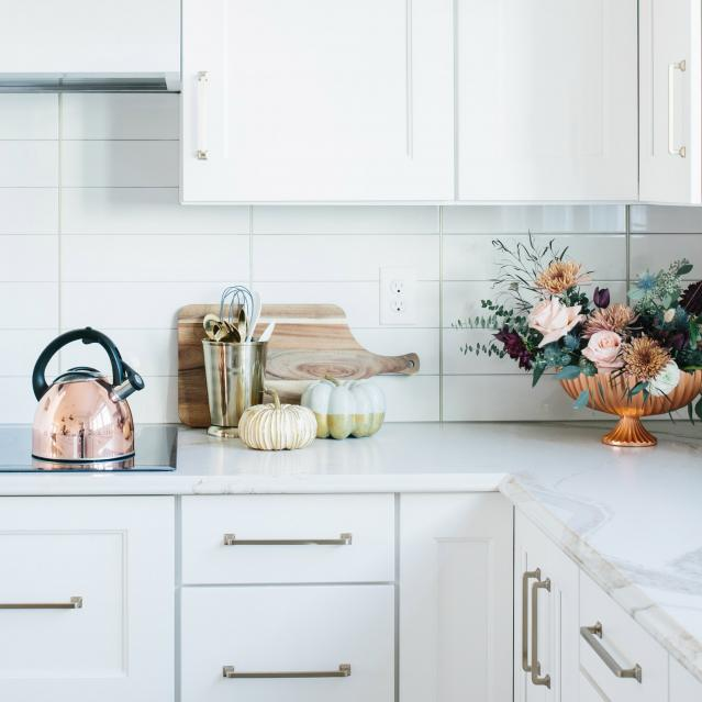 flowers and pumpkin decor in kitchen
