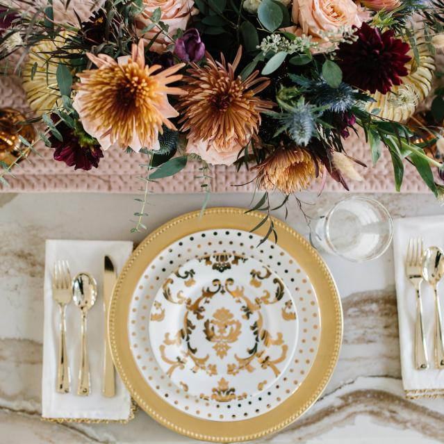 fall flowers and gold plate table setting