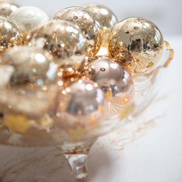 ornaments in gold glass bowl