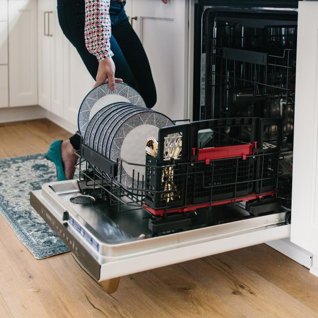 loading dishes in dishwasher