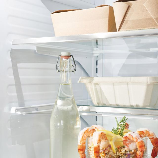 leftovers on top shelf in refrigerator