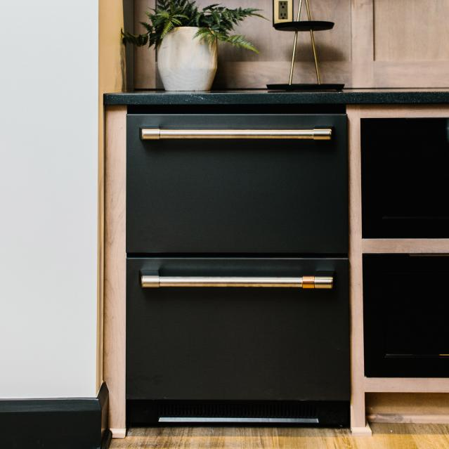 drawer refrigerator in tv room bar