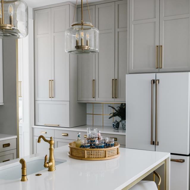 Kitchen designed by Gretchen black with white matte refrigerator
