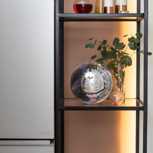 Disco ball on shelf by Modern Glass refrigerator