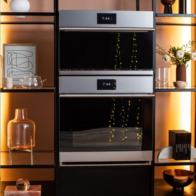 Twinkle lights reflected in wall ovens