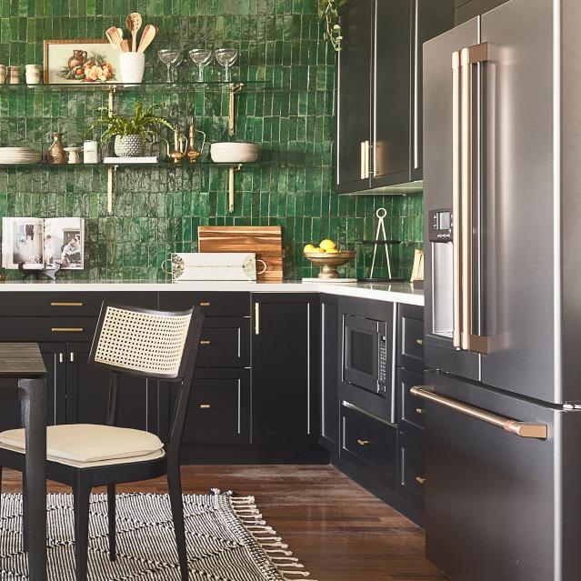 Bold green tile wall accents a kitchen with Matte Black appliances