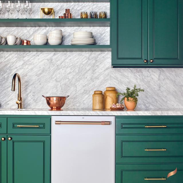 Matte white dishwasher in kitchen with bright green cabinets