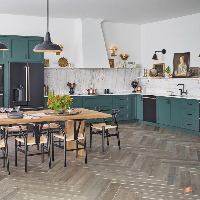 Matte black appliances in kitchen with sage green cabinets