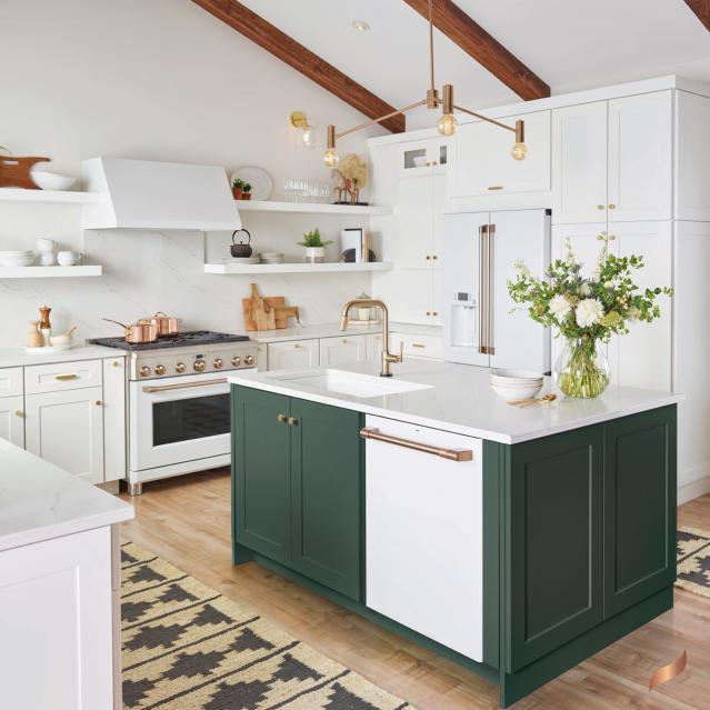 Matte white dishwasher in green cabinets
