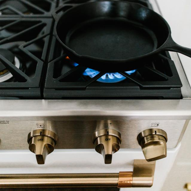 Cast iron pan on gas range with burner on