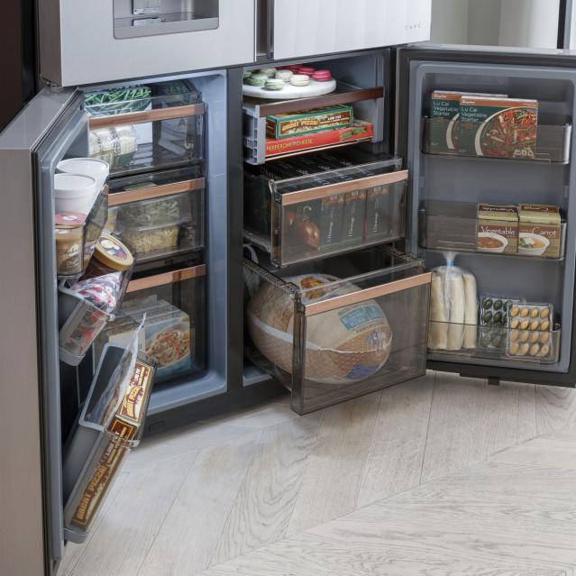 Quad door refrigerator with the bottom doors open